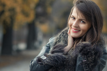 Portrait of a young smile woman wearing fur