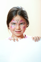 Beautiful young girl with face painted