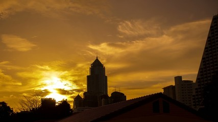 HD Timelapse. Golden sunset in Bangkok city view from the