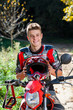 Handsome teen boy in motocross outfit.