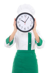 woman chef in uniform holding office clock behind her face isola