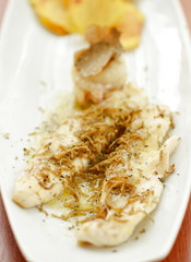 White fish fillet with black truffles