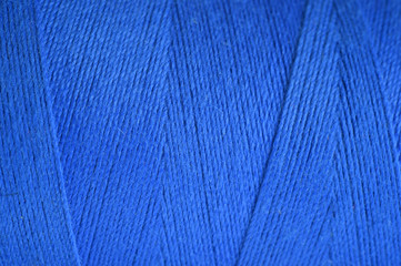 close up shot of blue yarn for background.
