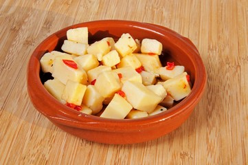 Cubed Manchego cheese with chilli in olive oil.