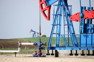 two oil pump jack and pipeline
