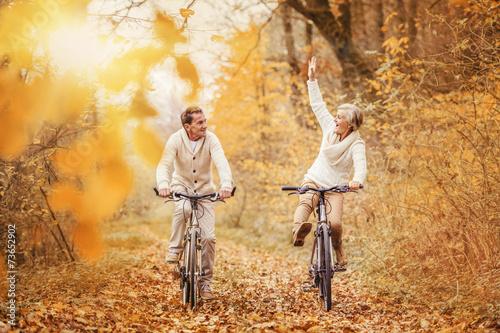 Leinwanddruck Bild Active seniors ridding bike and having fun