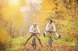 Leinwanddruck Bild - Active seniors ridding bike and having fun