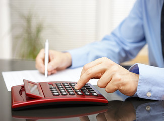 Businessman working in  office with calculator and fulfilling do