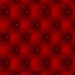 Red leather upholstery furniture. textured background