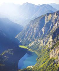 scenery of lake in high mountain with sun rays