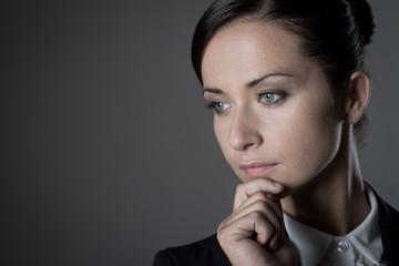 Attractive businesswoman on dark background