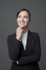 Smiling businesswoman with hand on chin