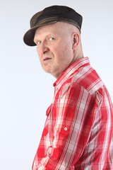 Portrait of an adult man in a plaid shirt