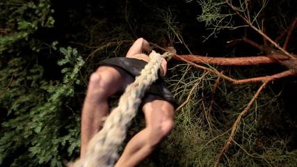 Man climbing od rope