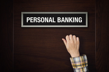 Hand is knocking on Personal banking door