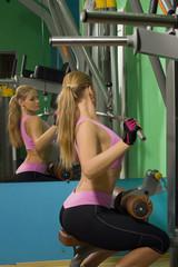 Fit female training in gym