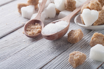 white and brown sugar close-up