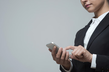 Businesswoman using mobile touch screen phone