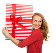 Happy young woman hold red Christmas wrapped gift present smilin