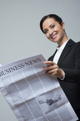 Businesswoman with financial newspaper