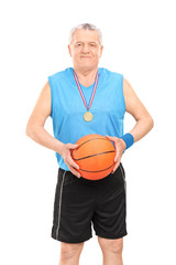 Mature basketball coach posing