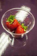 Fresh strawberries in a glass