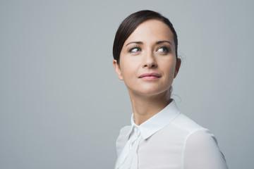 Charming smiling woman in white shirt