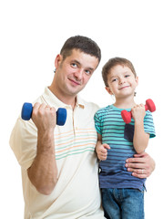 father and kid boy doing exercise with dumbbells together
