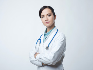 Confident female doctor with lab coat