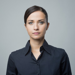 Serious woman in blue shirt