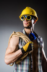 Ripped muscular builder man with tools