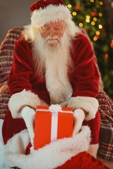 Portrait of santa stocking gifts in his sack