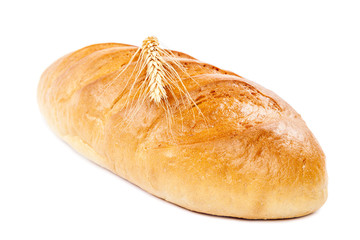 Bread loaf and wheat ear on white background.