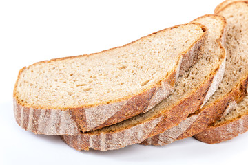 Stack of slices of bread on white background.