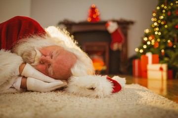 Santa claus resting on the rug