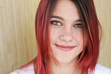 Portrait of beautiful girl with red hair and a nice smile