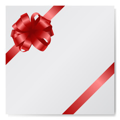 Red silk bow on empty paper card isolated at white background