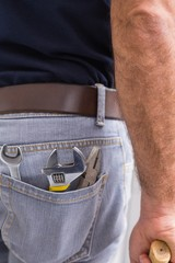 Handyman with tools in back pocket