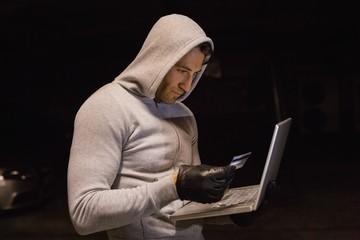 Man in hood jacket standing shopping online