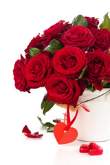 Red roses in bucket.
