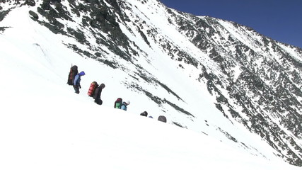 Climbers go down from the mountain pass