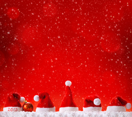 Christmas hats  isolated on red background.