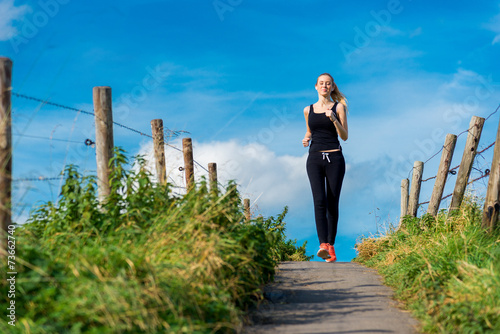 canvas print picture young blonde girl jogging