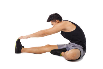 fitness man sitting and making stretching exercises