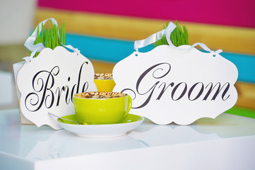 Bride and groom decoration boards on colorful background