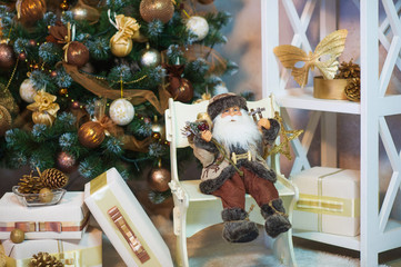 New Year festive mood with Santa toy and present boxes