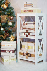 Shelf loaded with styled and wrapped present boxes