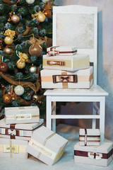 Beautifully styled and wrapped presents by the Christmas tree