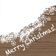 Merry Christmas - wooden background with snow