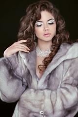 Beauty Fashion Model Girl in Blue Mink Fur Coat. Beautiful Luxur